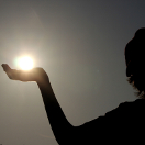 Child Holding Sun in his Hand